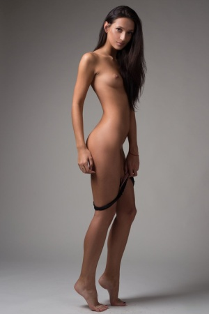 Attractive brunette Kenya strips to pose her perfect body naked on her knees