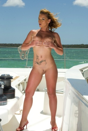 Pornstar Kathy Campbel gets fucked by two men on-board a sailboat