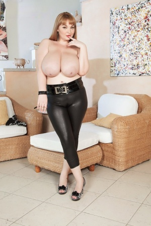 Solo model Micky Bells touts her massive tits before removing tight pants