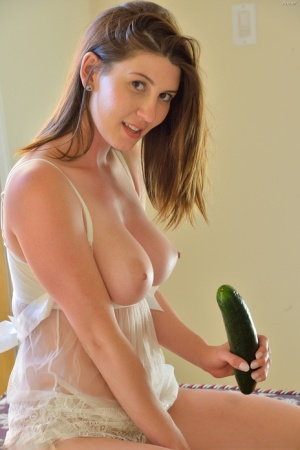 Solo girl in sheer dress flashes on walkway and gets freaky with a cucumber