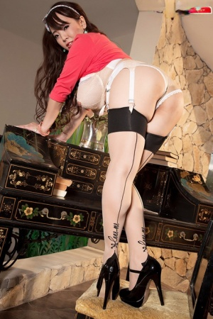 Asian solo model Hitomi unleashes her knockers in nylons and garters