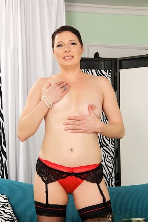 Solo model Kelly Karinena sports short hair while stripping to her stockings 73028629