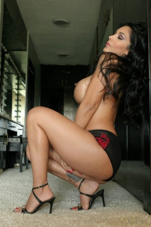Busty brunette MILF Mercedez squats naked showing off her huge boobs and twat