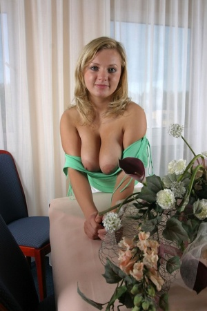 Blonde girl Malina May uncovers her big naturals in solo action