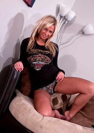 Blonde amateur Kendra Rain releases her tits from a black sweater and bra 53084115