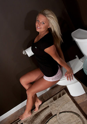 Blond amateur Kendra Rain goes topless in a white lace panties in the bathroom