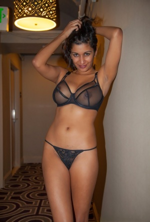 Amatuer Indian model CarlaWhite does an inviting strip to reveal her huge tits