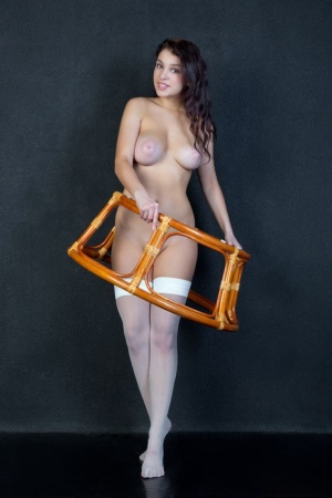 Horny young Evita Lima spreading wide open on a chair to show closeup pink