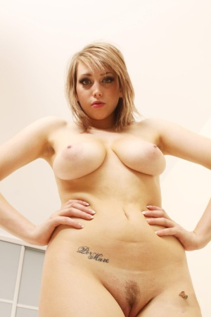 First timer Louisa May flaunts her great boobs after removing dress and bra