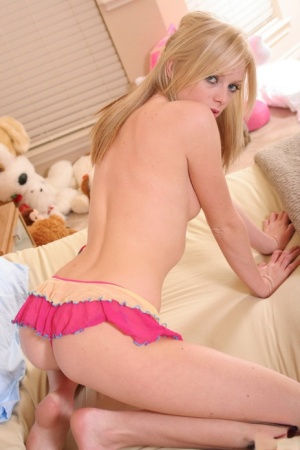 Young blonde Skye Model lets a nipple slip from three piece lingerie ensemble 38390658