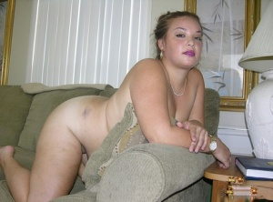 Amateur BBW Brittany K slips off her red dress to model totally naked at home 49120601