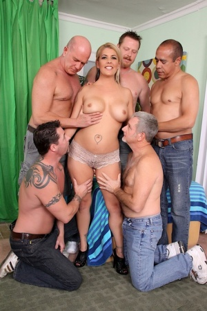 Blonde slut Joclyn Stone lives out her wildest dreams with a gangbang