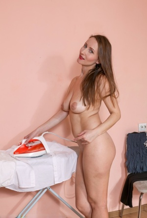 Slim mature housewife Alena K spreading legs for pussy closeup in the kitchen