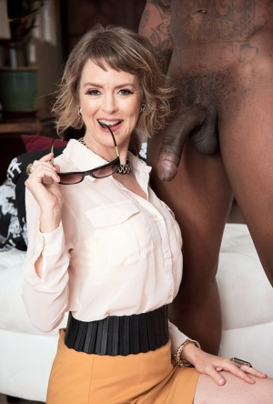 Older MILF Jamie Foster greets her black stud and his big dick in a skirt