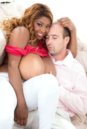 Thick black chick Rachel Raxxx has her massive boobs uncupped by white man