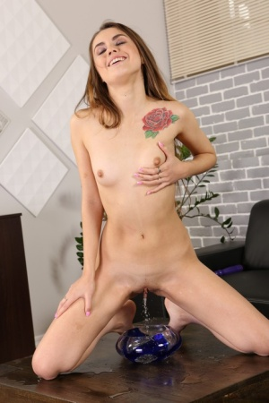 Horny female Ella Rosa licks up her own pee while masturbating by herself