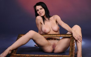 Dark haired girl Lydia R holds a picture frame while showing her great body 46518149