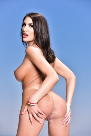 Brunette solo model August Ames takes off a red bikini in sexy manner