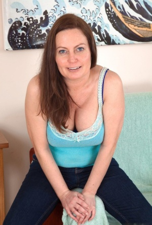 Older amateur Alexis May exposes her big naturals before showing her full bush