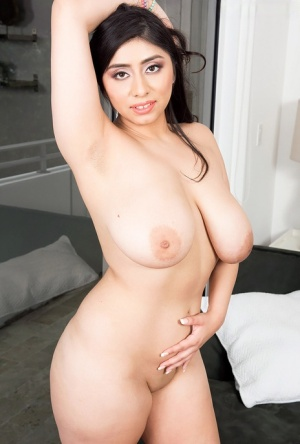 Thick solo girl Luna Bunny uncups great tits as she goes about getting naked