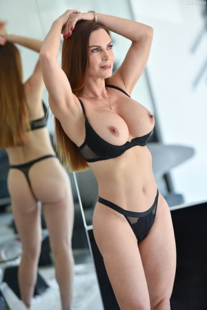Amateur model Danielle unveils her firm tits in as she strips to her underwear