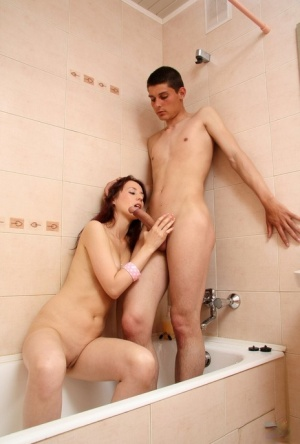 Young redhead Marina K and her man friend have sex in bathroom and bedroom 84498239