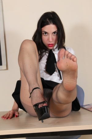 Clothed schoolgirl Magena frees her feet from heels in see thru pantyhose