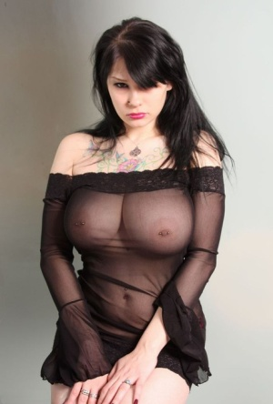 Sexy MILF Susy Rocks frees her huge tits from see through dress