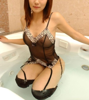 Cute Asian ex-gf models by herself in see thru lingerie and sexy nylons