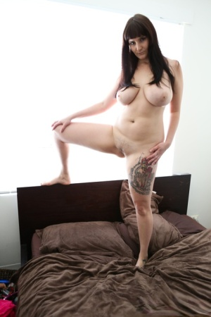 Thick amateur Envy B unveils big naturals before taking off thong underwear