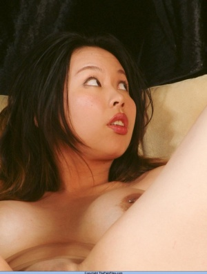 Asian girl finds herself having her pussy pegged with her legs restrained