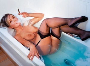 Smoking female goes ass to mouth with a BBC in black nylons