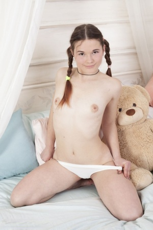 Adorable teen Harli showcases her shaved pussy in braided pigtails