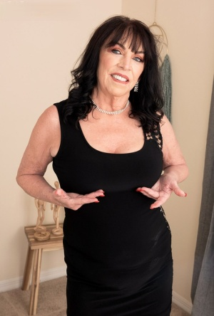Hot 70 plus lady Christina Starr seduces a much younger boy in a black dress