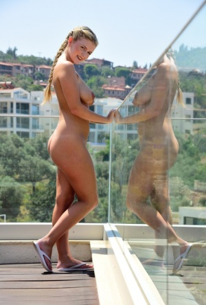Blonde first timer Lycia Sharyl gets naked on a penthouse balcony