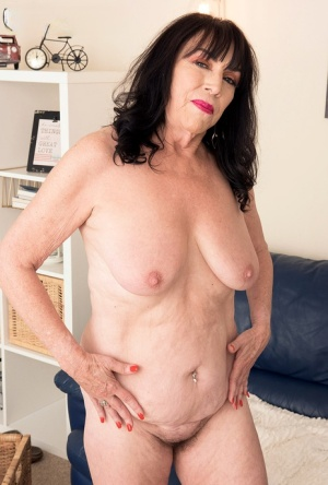 Hot granny Christina Starr plays with her saggy boob as she gets totally naked