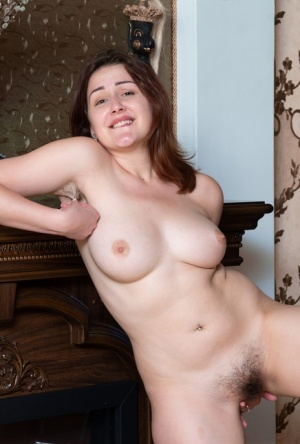 Busty amateur Ella Nori bares her beaver after showing off her furry armpits
