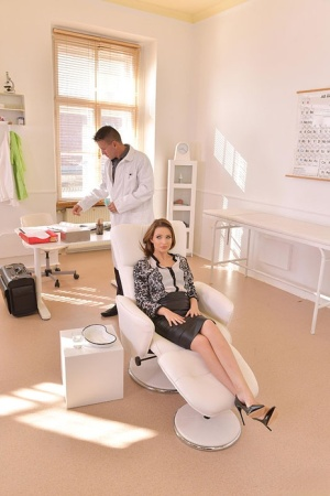 Clothed female Mia Ferrari gags on her dentist's cock while sitting in a chair 94300363