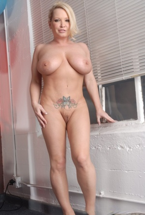 Busty blonde MILF Rachel Love removes bra and panty set before pussy play