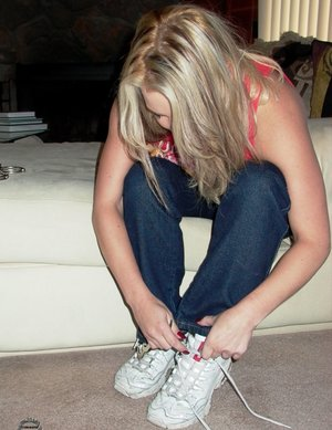 Older blonde Rachel Love paints her toenails while clothed and cuffed