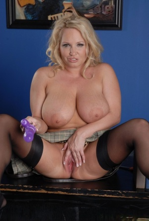 Big titted blonde Rachel Love plays with her snatch in nylons and garter 41030920