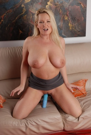 Solo girl Rachel Love sucks on her big boobs prior to toying her horny vagina