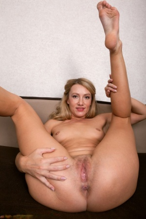 30 plus blonde Sunshine K takes off her uniform before toying her shaved pussy