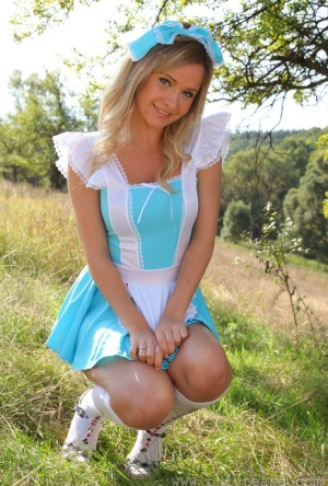 Cute blonde Elle Richie removes her cute outfit to pose topless in a field 20515587