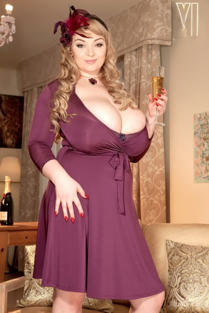 BBW solo girl Micky Bells uncorks her massive tits as she removes her dress