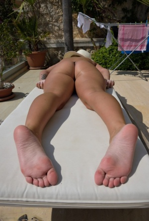 UK amateur Lycia Sharyl catches some sun on her hot body in a thong and hat 15937621