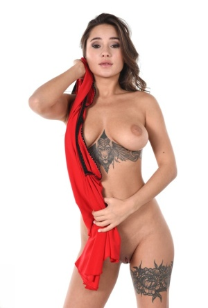 Tattooed female Liya Silver removes a red dress before dildoing her vagina 96613779