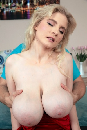 Leggy blond Casey Deluxe has her huge boobs groped and massaged
