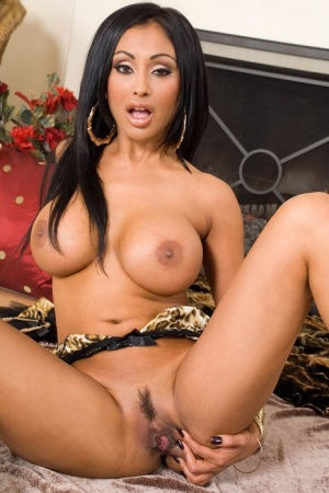 Busty Indian solo girl Priya Rai pleasures her landing strip pussy with a toy