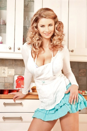 Solo girl Katarina Dubrova fills mouth with whipped cream after baring hooters